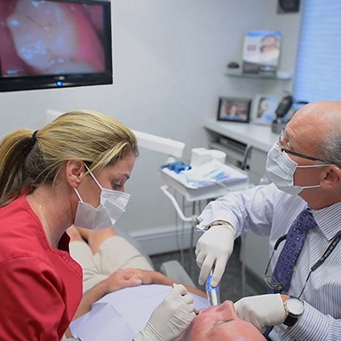 Dentist capturing intraoral photos