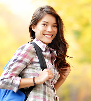 Woman with back pack smiling