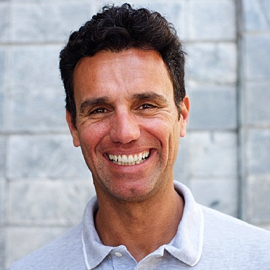 Smiling man with perfect teeth from best Long Island dental implant dentist, Dr. Allan Mohr