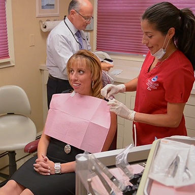 Dentist and assistant working with patient
