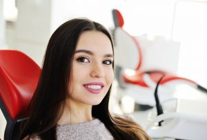 woman with dazzling smile thanks to a Long Island cosmetic dentist