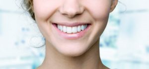 woman who has just gotten teeth whitening on Long Island