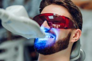 man receiving best Long Island teeth whitening