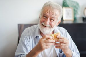 happy old man eating burger