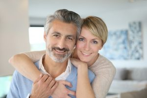smiling middle-aged couple in home