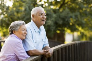 Senior couple enjoy afternoon on bridge